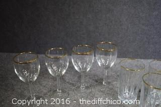 23 Pieces of Gold Rimmed Glassware
