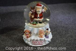 Rudolph Red-Nosed Reindeer Snowglobe Bank