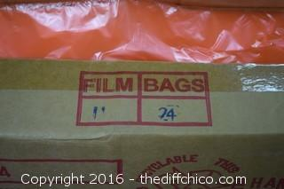 2 Boxes of New Orange Bags
