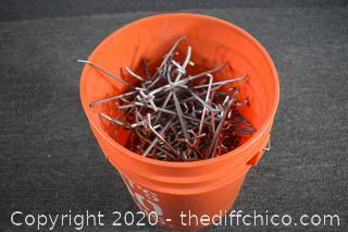 Bucket of Pegboard Hooks