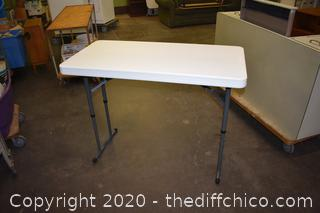 New Folding Table w/adjustable legs