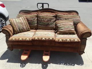 Couch w/ Carvings on Front of Arms and Back, Western Design