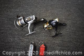 2 Fishing Reels plus 2 Water Tight Containers