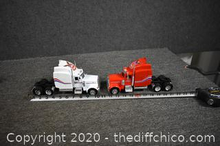 2 Peterbilt Die Cast and Plastic Trucks