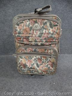 Olympia Rolling Luggage Suitcase
