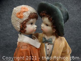 Boy & Girl Statue