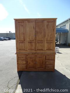 """2 Piece Solid Wood Entertainment Center T-85"""" X  W- 65 1/2"""" X D 21 1/2""""        (1 door has been repaired Bottom middle door )"""