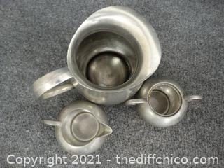 Silver Colored Pitcher And Sugar & Creamer dish