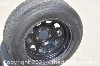 2 Bridgestone Tires plus 1 spare tire