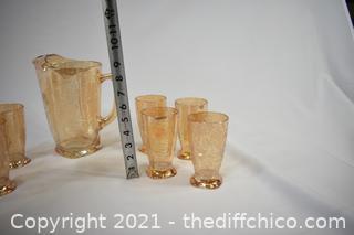 Marigold Carnival Glass Pitcher plus 8 Glasses