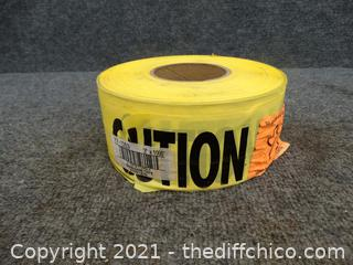New Roll Of Yellow Caution Tape