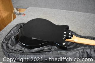 39 1/2in long First Act Electric Guitar w/ case