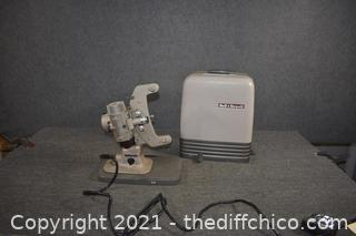 Working Bell and Howell Projector w/case