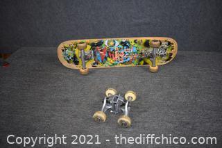 Skateboard w/extra wheels