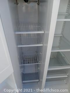 """GE Side By Side Refrigerator MOD # TFX20JR     wks With ice & Water In Door 66 1/2"""" x 31 1/2"""" x 34"""" with handles"""