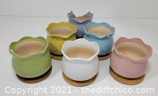 Six different color flower pottery bowls with coasters *one purple broken*