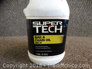Opened Super Tech Bar and Chain Oil