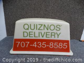 Quiznos light up car top
