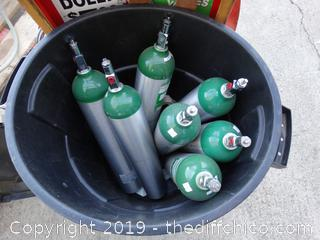 7 Oxygen Bottles With Trash Can