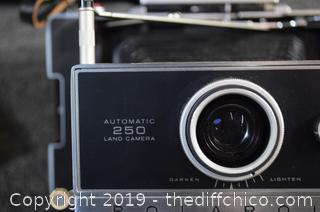 Polaroid Automatic 250 Land Camera, Light Bulbs, Case and More