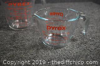 2 Pyrex Measuring Cups