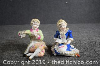 Pair of Porcelain Statues