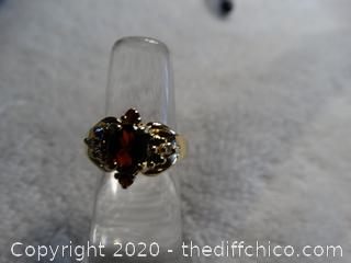 Ring With Burgundy Stone & Small side Side stones 4 3/4