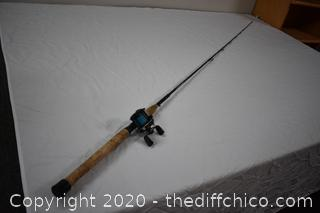 89 1/2in long RetrOflex Fishing Pole and Daiwa Reel