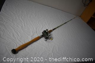 85in long True Temper Fishing Pole and Penn Reel 350