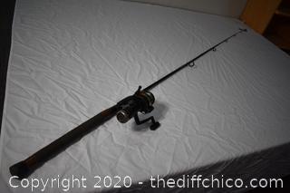 89in long Ugly Stik Fishing Pole and Quantum Reel