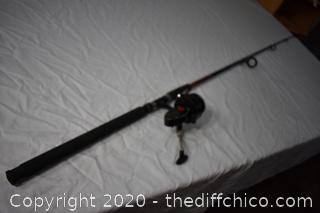 96 1/2in long Shimano Fishing Pole and Mitchell Reel