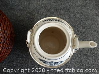 Tea Pot In Basket