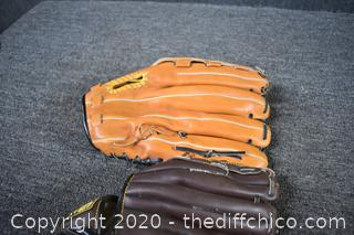 2 Right Handed Baseball Gloves