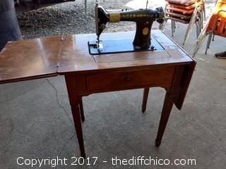 Singer Sewing Machine and Cabinet - Model #AD148719