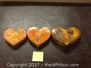 3 hand carved wooden hearts