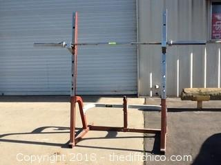 metal squat rack with olympic bar