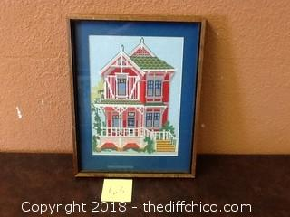 old needle point picture in frame