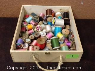 box of sewing machine thread