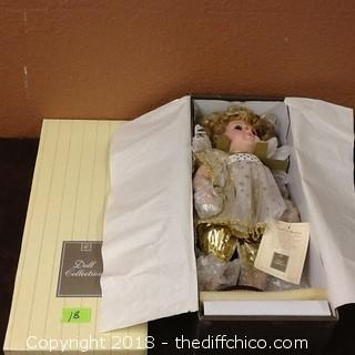 new in box Doll collection doll
