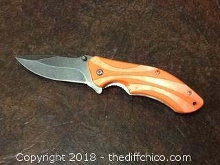 new orange pocket knife