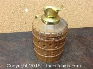 wood and brass water pitcher