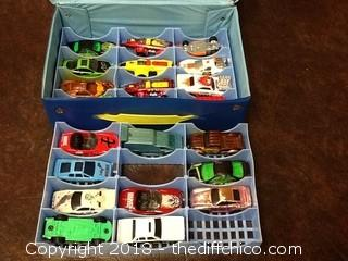 two matchbox/hotwheels car cases with cars