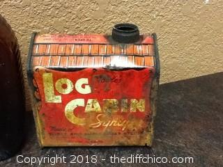 vintage log cabin syrup bottles and tin