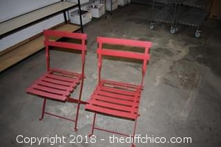 2 Folding Red Metal Chairs